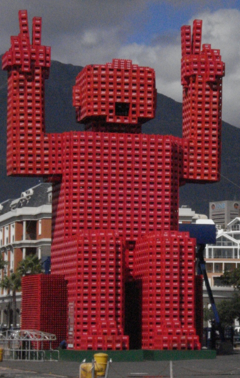 Lego-like man build out of coke crates at the Waterfront in Cape Town