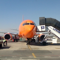 A plane - in South Africa painted brightly orange