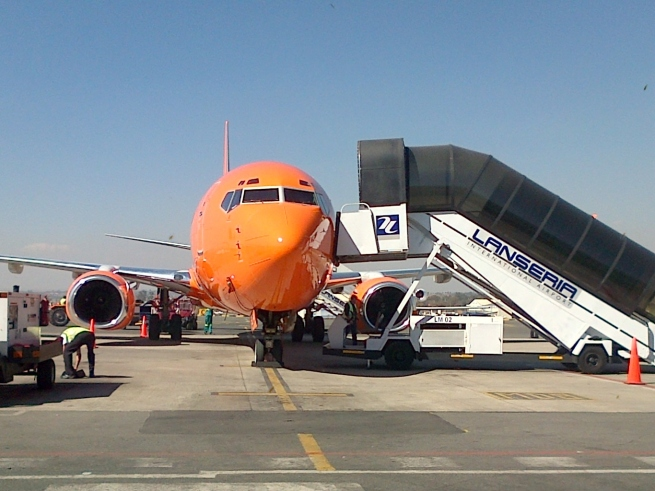 Mango Airlines -  in South Africa  painted brightly orange