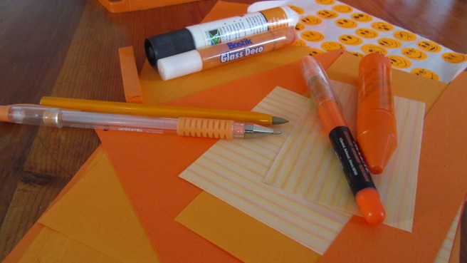 Orange stationery and art supplies