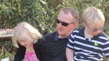 Grandfather with his grandchildren