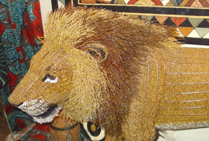 I have used this photo before to illustrate the colour gold, it is still the best I can find. A loin made with thousands of golden beads